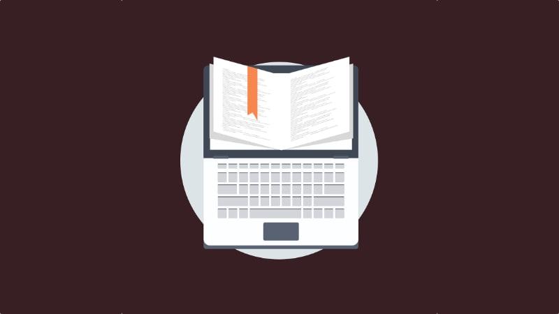 "Symbolbild ""Laptop Buch"""